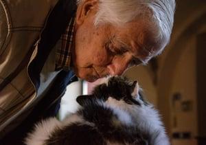 older gentleman with pet cat