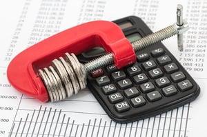 budgeting - saving money with calculator