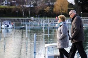 older couple walking near water