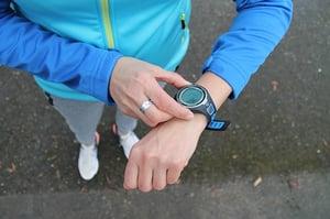 Woman wearing fitness tracker watch wearable technology