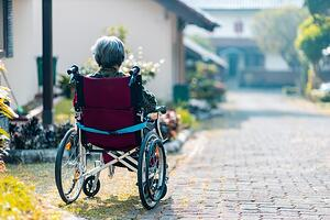 Older woman with dementia sitting a wheelchair