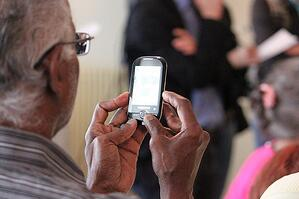 older man using mobile cell phone