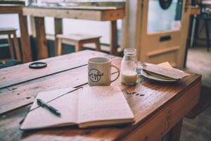open notebook food jourmal on table
