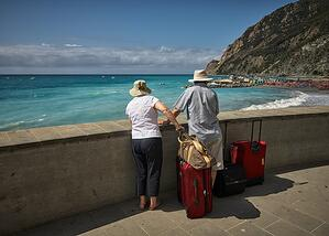 retiree couple outdoors on a summer vacation