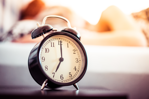 vintage-alarm-clock-and-sleeping-woman-picjumbo-com