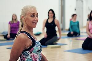 older woman participating in yoga class